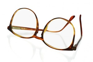 Old fashion large frame plastic spectacles on white background